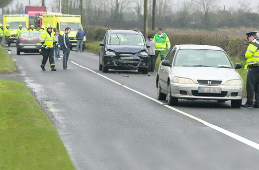 Emergency services at the scene of a crash on the Drogheda to Termonfeckin road last Thursday evening. Photo: Paul Connor