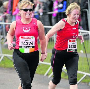 Mary Reilly, left, and Margo Duffy during the SPAR Great Ireland Run in Phoenix Park on Sunday. Photo: Pat Murphy