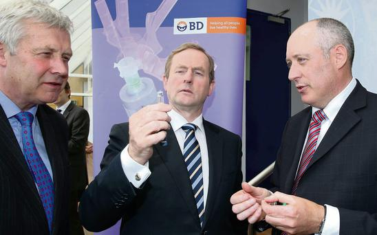 The late Minister of State, Fergus O'Dowd; An Taoiseach, Enda Kenny; and Cormac Reynolds, Director, Diabetes Care Manufacturing, BD in Ireland, at the announcement of 28 new jobs at BD's Drogheda plant on the Donore Road last year