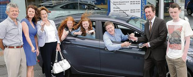 Lorraine Duff collects the keys to her new Ford Fiesta at N Smith and Sons Ford garage.
