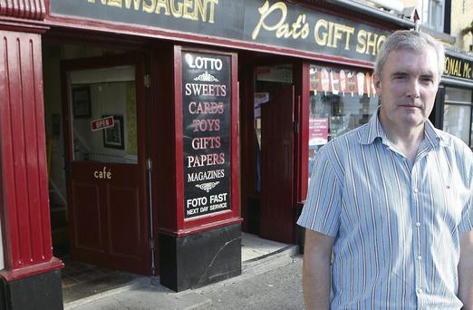Joe Torris pictured outside his Dunleer shop where two cars crashed into the shop front on last Tuesday.