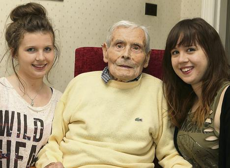 102-year-old Con McLoughlin with his grandaughters Sarah and Rebecca.
