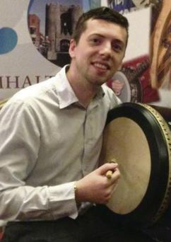 Conor Mohan from Wm. Cairnes and Sons who is learning to play the bodhran.