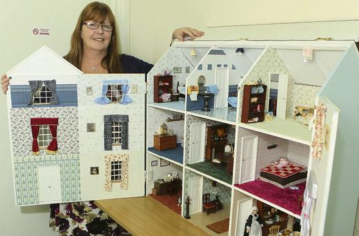 Janet Dunne with her handmade doll's house which will be raffled off to raise money for the Drogheda branch of the Samaritans.