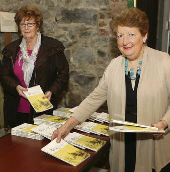 Carmel Doherty and Deirdre Howard-Russell getting ready for the launch of the 20th journal in the Governor's House at Millmount.