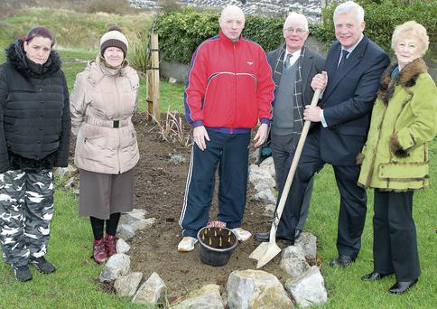 Minister of State Fergus O'Dowd presents some bulbs to the Rathmullen Community Garden project, which were gratefully accepted by Helen Finnegan, Moe McDonagh, Eddie Sweeney, Paddy Smith and Carmel Clarke.