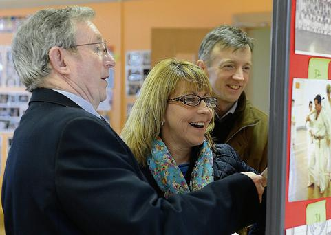 Phil Nulty, Lorraine O'Neill and her husband Max looking at some of the photos at the exhibition to mark 45 years of Drogheda School of Karate.