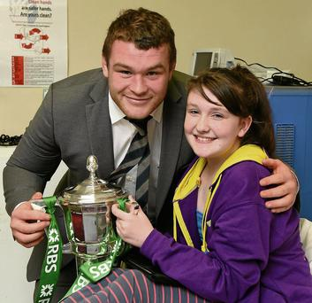 Dunleer girl Lauren McCullough meets Ireland and Leinster rugby star Jack McGrath with the Six Nations trophy at Temple Street Children's Hospital last week.