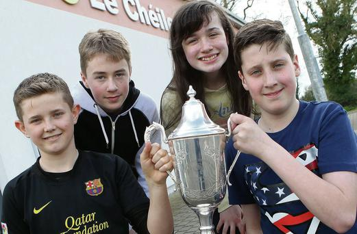 Le Cheile Educate Toghether NS senior quiz team members Andrew Keane, Jonathan Clear, Ferdia Quigley and Aoife Finn Gallagher with the All-Ireland Credit Union Quiz trophy.