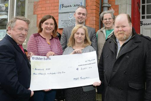 Tony Browne, Catriona Culligan, Anita O'Shea, Michael Deasy, Sr. Agnes and David Pendlebury with the cheque for €3,650 for the Boomerang Cafe from the Million Dollar Round Table Foundation in America.