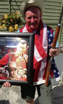 Paddy 'the Duke' Dyas shows off some of his John Wayne collection.