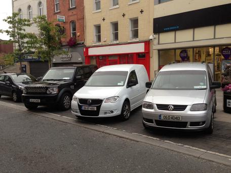 Three vans parked at an angle on West Street and still loads of room. It shows a new parking system can work.