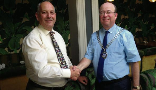 Darius Messayeh, Incoming President of Drogheda Rotary accepting the chains of office from Richard Schmidt.