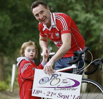 Peter Fitzpatrick, TD and Former Loth Football Manager pictured with Poppy Stephenson, aged 6 from Drogheda at the launch of Down Syndrome Ireland's Tour de Leinster cycle.