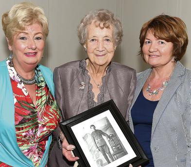 Lillian Brayshaw, Theresa Norris and Theresa's daughter Mary McCabe holding a photo of Theresa's husband's uncle Thomas Norris, who was killed on October 7, 1915.