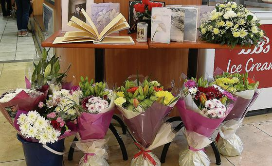 Book of condolences and floral tributes to the late Paul Lloyd manager of BB's restaurant in Scotch Hall and The Laurence Town Centre. Photo:Colin Bell/pressphotos.ie