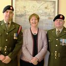 Members of the Defence Forces and Mary Gallagher at the national flag ceremony in Ardee Monastery NS