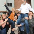Sinn Fein candidates, Imelda Munster and Gerry Adams, celebrating after being elected to Dail Eireann at the General Election count in The Ramada Resort Hotel