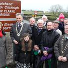Members of the Clarke family with officials from Meath and Louth County Councils at the renaming of the bridge at Rossin on Friday