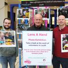 Stephen Clarke, Shay Durnin and Micky Rogers setting up the photo exhibition in Drogheda Town Centre