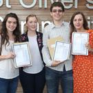 Irene McDonnell, Daniel Danev and Sarah McKenna with their teacher Emma Carroll on leaving cert results day