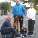 Curtis Meade and Hugh Rooney with All Ireland prize winning dog Ruby. Also pictured are Hugh's grandsons Dillon and Craig.