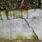 The damaged boundary wall at the site under debate