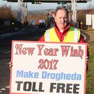 Former councillor Ken O Heiligh protests on Sunday