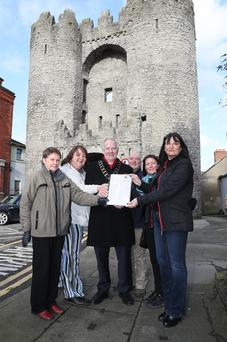Close the Gate campaigners presenting their petition to Mayor Oliver Tully.