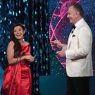 Aoife Heffron Louth Rose onstage with Daithi Ó Sé in the Rose of Tralee International Festival Dome during TV Rose Selection. Photo:Domnick Walsh