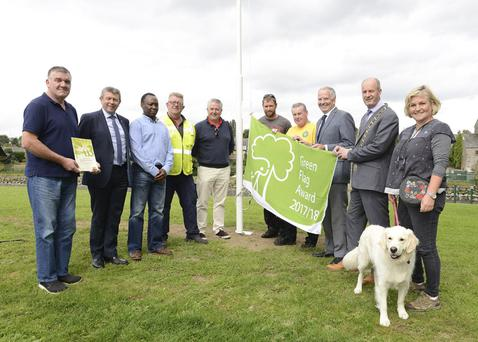 Pictured at the raising of the green flag at Dominick's Park, Tony Kenny Drogheda Municipal Council, Paddy Donnelly senior executive, Louth county council, Ellis Milmbila, Ramparks Attendant, Tommy Cunningham, Stephem Lynch and David Cunningham, Cllr David Saurin, Cllr Oliver Tully, Mayor Pio Smith, Aine Walsh, Tidy Towns, and her dog Daisy.