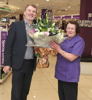 Paddy Hickey presents a bouquet to Anne Devine