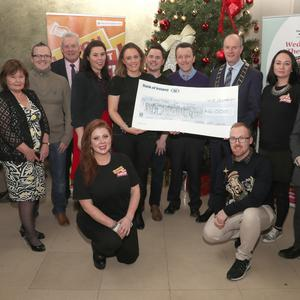 The committee and supporters of the Laugh Out Louth festival pictured with the cheque that was presented to the Samaritans.