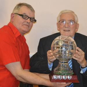 Tom McCormack, Stoney Lane, Ardee receiving his Hall of Fame trophy from Gus Carroll, vice chairman of Hunterstown Rovers