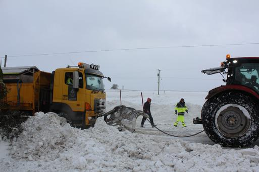Even the snow plough needed a helping hand on the N2 at Koockacleva, Collon on Friday. Picture: Declan Monaghan
