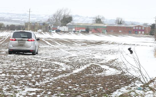 Cars were using a field to get around the blocked Ballymakenny Road
