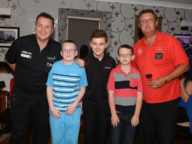 Keane Barry, Tiernan Barron and David Andrews pictured with 5-times Embassy World Professional Darts Champion and 5-times world masters winner Eric Bristow with 1-time Embassy World Professional Darts Champion Keith Deller at the Morning Star in Tullyallen. Photo:Colin Bell/pressphotos.ie