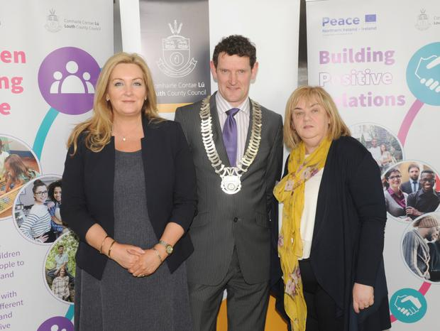 Gina McIntyre, Chief Executive Officer of the Special EU Programmes Body, Cllr. Colm Markey and Joan Martin, Louth County Council at the launch of the Louth County Council Peace IV action plan in The Crowne Plaza