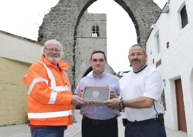 Kevin Callan, Chairman, Tidy Towns, with John Bannon and Eugene Branigan at the Old Abbey