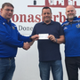 Jackpot winner of the Naomh Mairtin lotto, Paddy Crocock from Tullyallen, receiving his winning €17,000 prize from Club Treasurer Joe Walsh along with ticket seller Ged Byrne