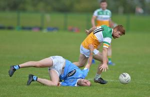 Daire Smyth collects possession as John Connolly takes an awkward tumble. Pictures: Ken Finegan