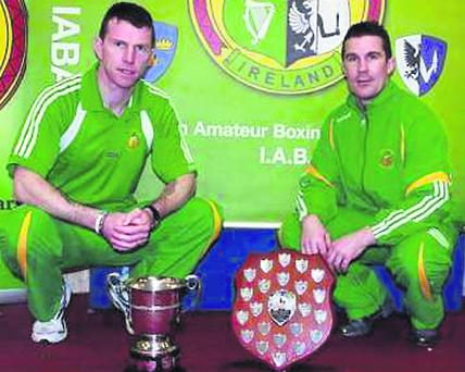 Damien McKenna and Fergal Fagan with the Best Club awards won by Holy Family BC for the 2012 Michael Andrews and 2013 Leinster Youths Championships.