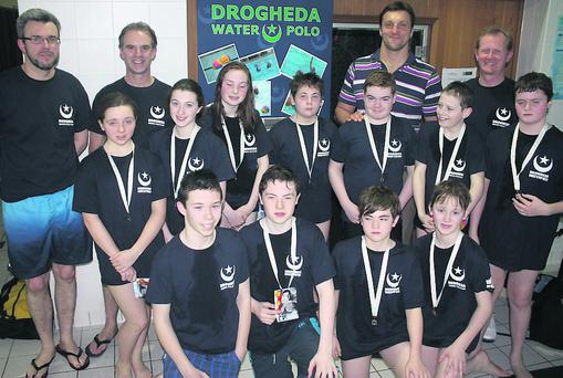 Drogheda's Under-14 water polo squad with three-time Olympic gold medallist and two-time World Player of the Year, Gergely Kiss, from Hungary.