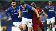 Seamus Coleman of Everton outmuscles Sadio Mane of Liverpool during the Merseyside derby on Sunday.