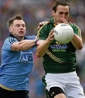 Graham Reilly, who had a disappointing game, takes on Philip McMahon.