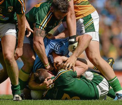 The incident that provided one of the main talking points of the Leinster final as Mickey Burke and Kevin Reilly of Meath tussle with Dublin's Eoghan O'Gara.