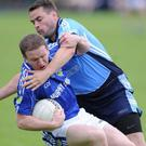 Kevin Callaghan, Roche, under pressure from Paul O'Brien, Glyde Rangers