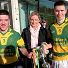 Olive Feeley, daughter of the late Noel Curran, with Killary Emmets' Jamie McMahon and captain Jack Reid following the presentation of the Curran Cup for the MFC Division 3