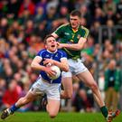 Tomas Corr, Cavan, and Adam Flanagan, Meath, in action