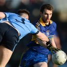 David Dalton of Summerhill is challenged by Stephen Moran of Simonstown Gaels